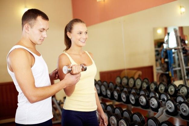 personal trainer helping his partner_1098 638