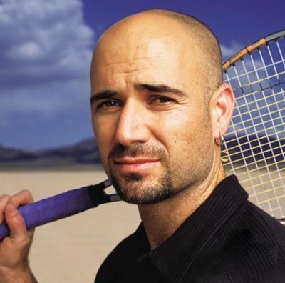 Andre Agassi Holding a Tennis Racket
