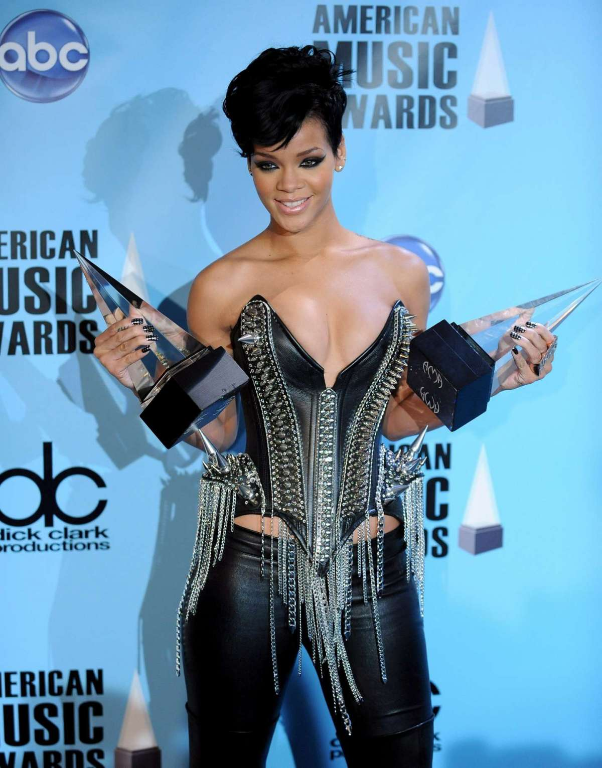 Rihanna poses with her awards for favorite female artist in the pop-rock and soul-R & B - American Music Awards in Los Angeles - 2008